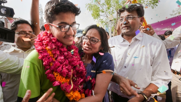 All India National Eligibility cum Entrance Test (NEET) topper Nalin Khandelwal celebrates with his parents after the declaration of results in Jaipur.