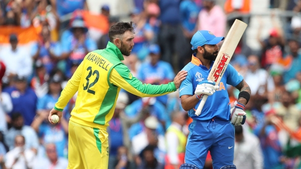 India's captain Virat Kohli, right, celebrates scoring fifty runs as Australia's Glenn Maxwell asks him to move on the other side of wicket to let him bowl during the Cricket World Cup match between Australia and India at The Oval in London, Sunday, June 9, 2019.