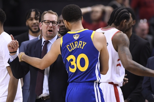 Toronto Raptors head coach Nick Nurse and Golden State Warriors guard Stephen Curry (30) exchange words.