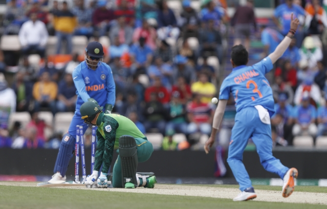 South Africa's Rassie van der Dussen isclean bowled by India's Yuzvendra Chahal during their Cricket World Cup match between South Africa and India.