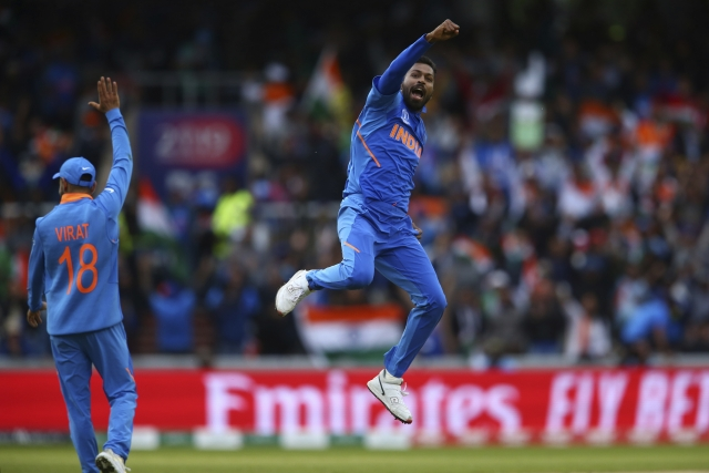 India's Hardik Pandya, right, celebrates taking the wicket of Pakistan's Shoaib Malik during the Cricket World Cup.