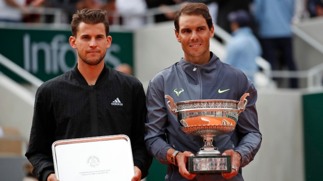 Thiem (left), who had beaten his opponent four times on clay in his career, failed to claim a single point off Nadal's first five service games of the second set.