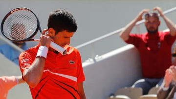 Novak Djokovic's 26-match Grand Slam winning streak ended with a dramatic 6-2, 3-6, 7-5, 5-7, 7-5 loss to Dominic Thiem.