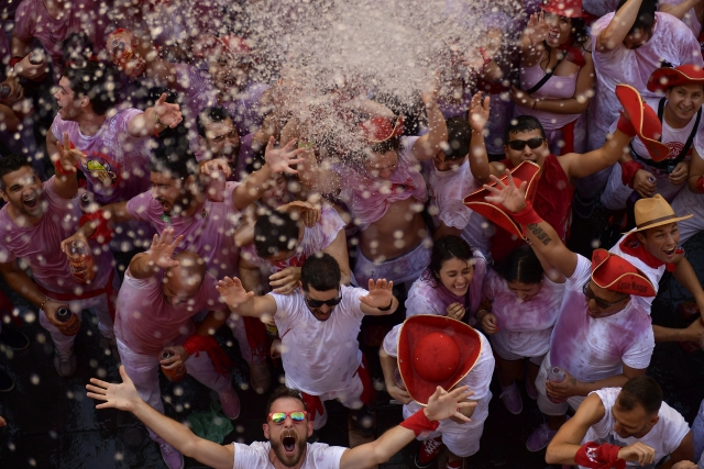 People wait for the launch of the 'Chupinazo' rocket, to celebrate the official opening of the 2019 San Fermin fiestas with daily bull runs, bullfights, music and dancing in Pamplona, Spain.