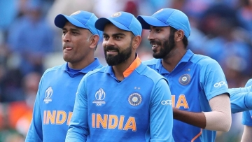 India's captain Virat Kohli, second left, and teammates leave the field after their win over Bangladesh in the Cricket World Cup match at Edgbaston.