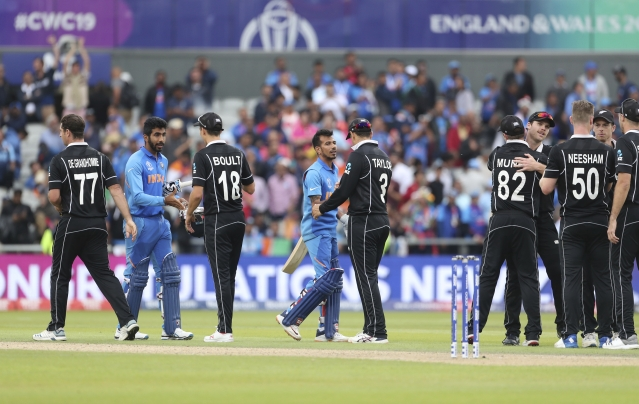 New Zealand players greet Indian batsmen Jasprit Bumrah, second left, and Yuzvendra Chahal, fourth left, after their win in the Cricket World Cup semi-final match between India and New Zealand at Old Trafford in Manchester, England, Wednesday, July 10, 2019.