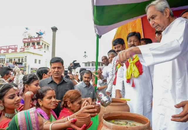 Odisha Chief Minister Naveen Patnaik distributes Abhada Torani to devotees during the annual Rath Yatra in Puri.