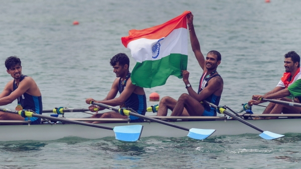 File picture of Indian rowing Men's team member Bhokanal Dattu holds the national flag as he celebrates after winning the gold medal in Men's Quadruple Sculls.
