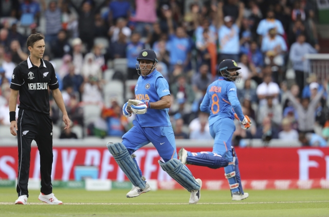 Ravindra Jadeja (R) and Mahendra Singh Dhoni during match between India and New Zealand at Old Trafford in Manchester.