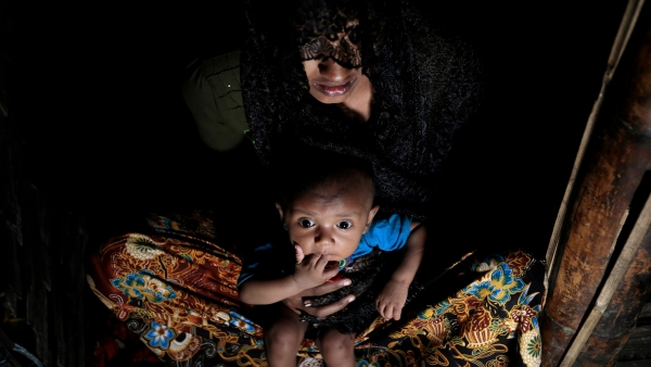 A Dec 2016 file photo of Mohsena Begum, a Rohingya who escaped to Bangladesh from Myanmar, holding her child at an unregistered refugee camp in Teknaf. Image used for representational purposes.