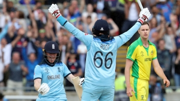 England's captain Eoin Morgan, left, celebrates with teammate Joe Root after winning the Cricket World Cup semi-final match between Australia and England at Edgbaston in Birmingham.