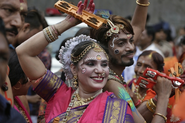 Devotees dance during the annual festival of Rath Yatra.