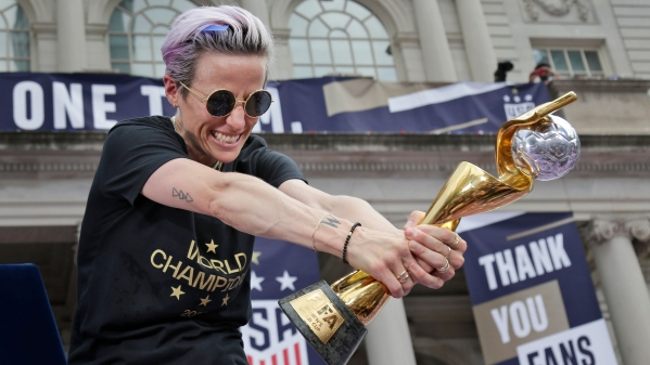 Megan Rapinoe holding the FIFA Women World Cup trophy