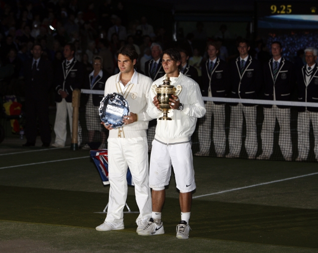 In this Sunday, July 6, 2008 file photo Spain's Rafael Nadal right, stands with the winners trophy next to Switzerland's Roger Federer after the men's singles final on the Centre Court at Wimbledon.
