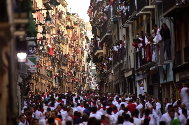 Revellers in the street ahead of the running of the bulls during the San Fermin Festival, in Pamplona, northern Spain.
