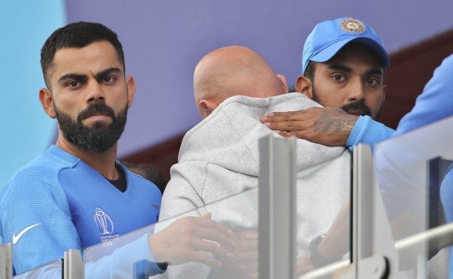 India's captain Virat Kohli, left, and India's K.L. Rahul, right, react after their loss in the Cricket World Cup semi-final match against New Zealand at Old Trafford in Manchester, England, Wednesday, July 10, 2019.