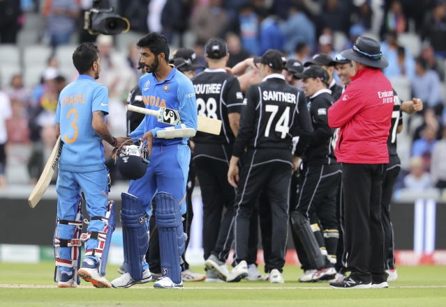 India's Yuzvendra Chahal, left, and India's Jasprit Bumrah react after their team lost the Cricket World Cup semifinal match between India and New Zealand at Old Trafford in Manchester, Wednesday, July 10, 2019.