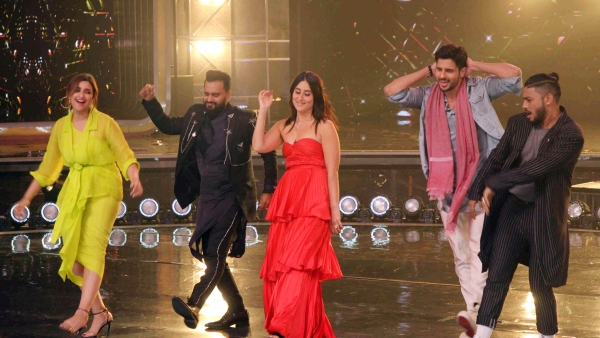 Sidharth Malhotra and Parineeti Chopra shake a leg with Kareena Kapoor and other judges of Dance India Dance.
