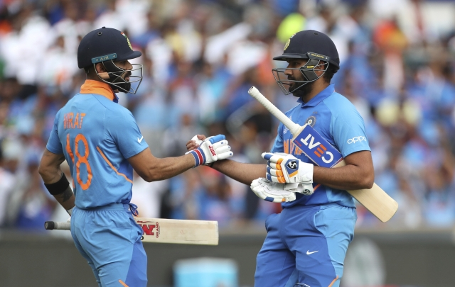Virat Kohli & Rohit Sharma during the Cricket World Cup match against Sri Lanka on 6 July.