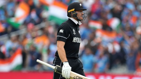 New Zealand's Martin Guptill leaves the field after being dismissed by India's Jasprit Bumrah during the Cricket World Cup semi-final match between India and New Zealand.