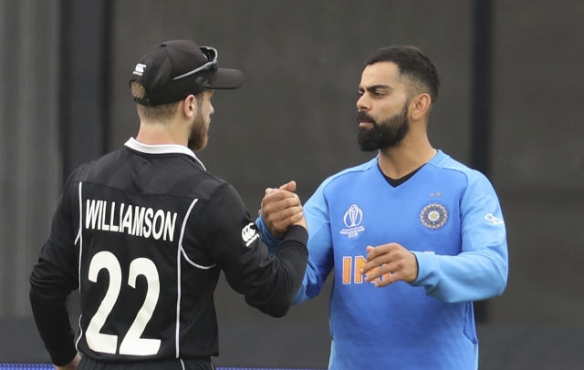 India's captain Virat Kohli, right, congratulates New Zealand's captain Kane Williamson for winning their Cricket World Cup semifinal match at Old Trafford in Manchester, Wednesday, July 10, 2019.