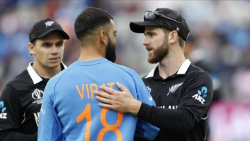 Kane Williamson is congratulated by Virat Kohli as New Zealand qualified for the 2019 World Cup final.