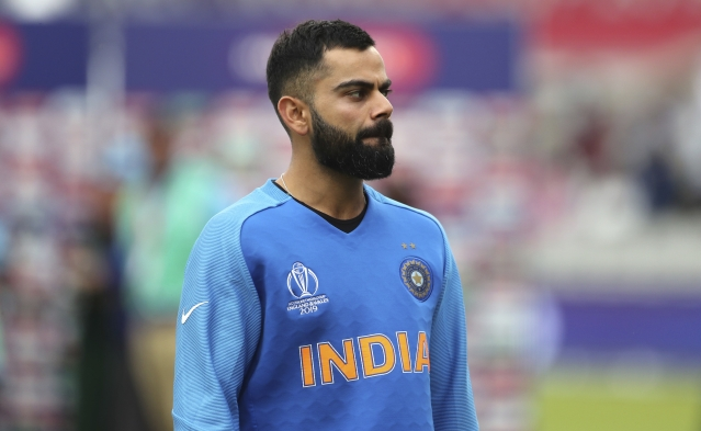 India's captain Virat Kohli reacts after their loss in the Cricket World Cup semi-final match against New Zealand at Old Trafford in Manchester, England, Wednesday, July 10, 2019.