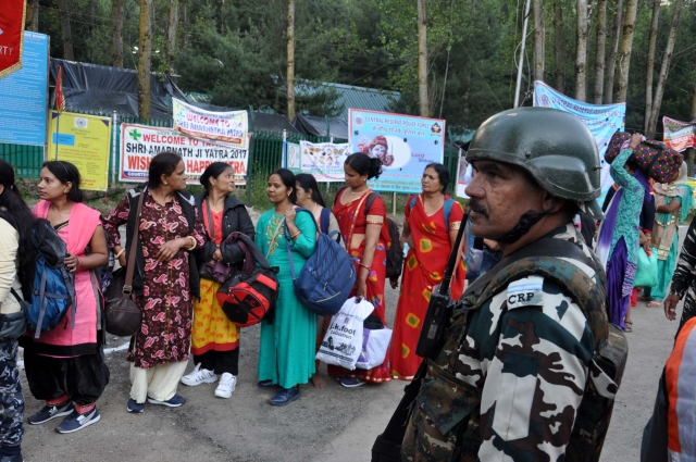 Heavy security as pilgrims wait in queue on the way to Amarnath yatra.