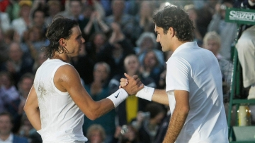 In this Sunday, July 6, 2008 file photo Spain's Rafael Nadal left, shakes the hand of Switzerland's Roger Federer after winning the men's final on the Centre Court at Wimbledon.
