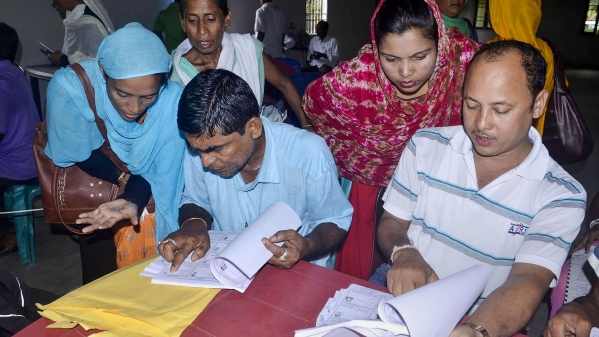 People check their names on the NRC final list at an NRC centre in Buraburi Gaon, Morigaon, Assam on 31 August.