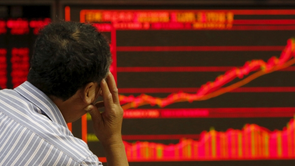 An investor watches an electronic board showing stock information at a brokerage office in Beijing, China, July 9, 2015. Image used for representational purposes.