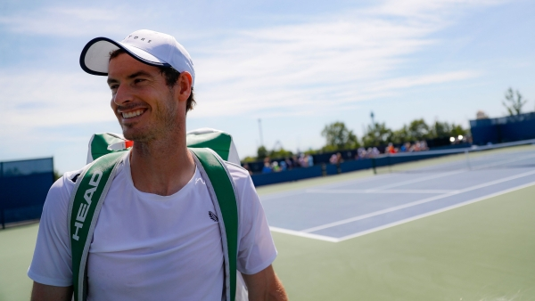 Andy Murray, of Britain, smiles after practice at the Western & Southern Open tennis tournament, Sunday, Sunday, Aug. 11, 2019, in Mason, Ohio.