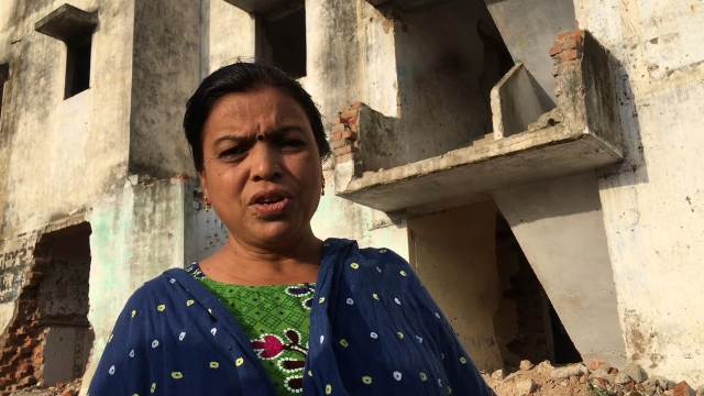 Maya Naik is a diamond polisher who purchased a flat in the low income housing scheme before it was demolished on a power of attorney.