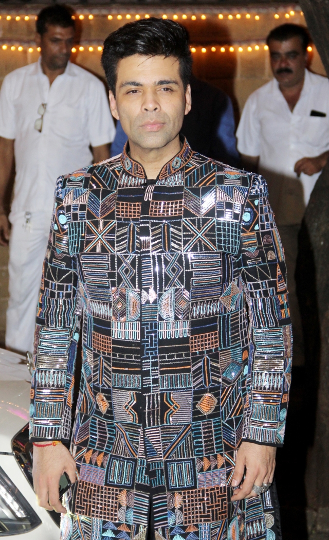 Karan Johar was spotted posing outside the Kapoor home.