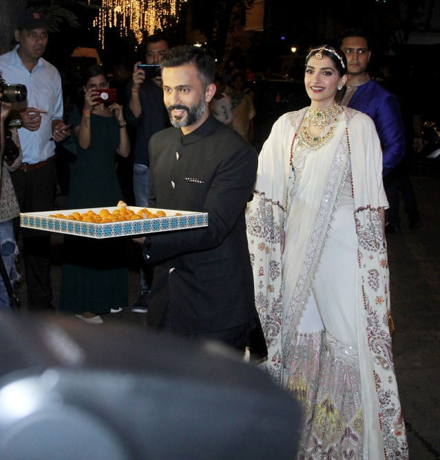 Sonam Kapoor and Anand Ahuja play host at the Diwali party.