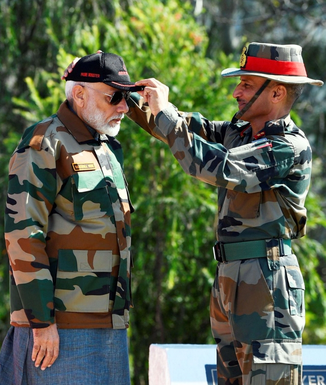 A jawan presented a cap to Prime Minister Narendra Modi during celebrating the Diwali with the jawans of the Indian Army, in J&K's Rajouri.