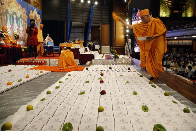 Traders and Devotees of Swami Narayan sect Performing Chopda (Book) pooja on the day of Laxmi Pujan in Mumbai.
