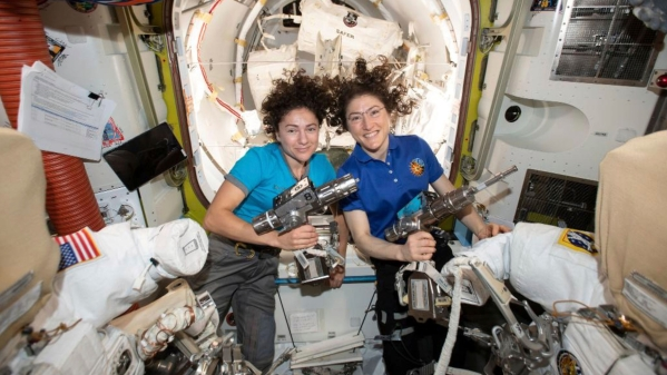 In this photo released by NASA on Thursday, 17 October, US astronauts Jessica Meir, left, and Christina Koch pose for a photo in the International Space Station.
