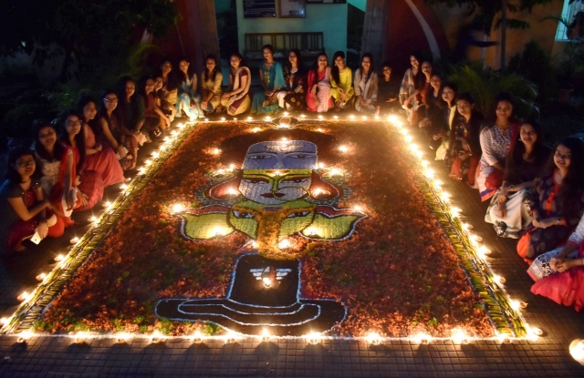 Students of Cotton University decorating Rangoli with Diyas (earthern lamps) on the occasion of Diwali festival in Guwahati.
