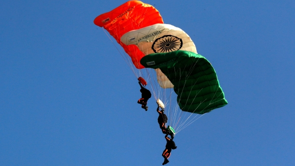 Members of Akash Ganga sky diving team of the Indian Air Force display their skill during the Air Force Day parade at the Hindon air base on the outskirts of New Delhi on Tuesday, 8 October.