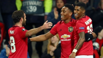 Manchester United's Anthony Martial, center, celebrates with Juan Mata and Marcus Rashford.