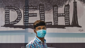 New Delhi: A boy is seen wearing a mask to get protection from air-pollution, in New Delhi, Friday, 1 Nov, 2019.