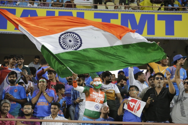 An Indian fan with his body painted cheers and waves Indian flag before the start of second Twenty20 international cricket match between India and Bangladesh at Saurashtra Cricket Association stadium in Rajkot.