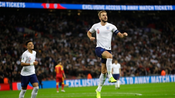 England's Harry Kane, right, celebrates scoring the fifth goal during the Euro 2020 group A qualifying football match between England and Montenegro at Wembley stadium in London.