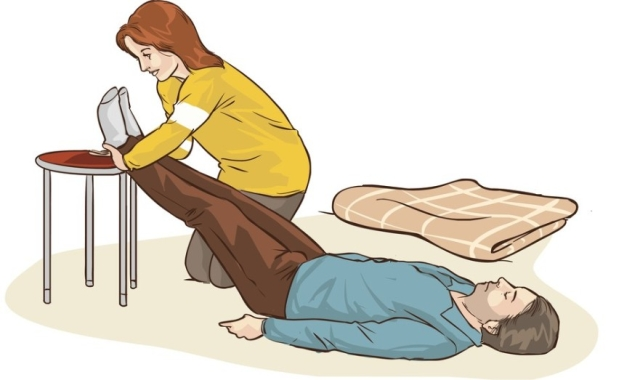Here's how to lift the person's legs above the ground when they're unconscious.
