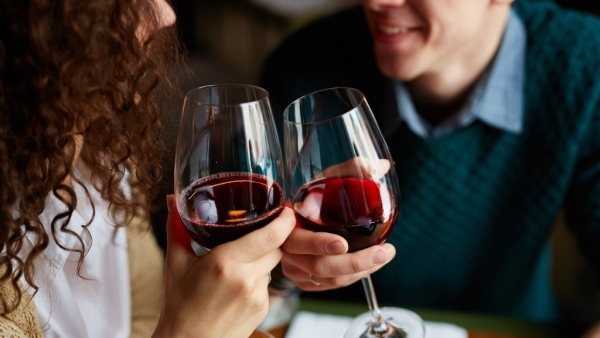 When my son was out, I chatted with his friend over wine and we ended up kissing.