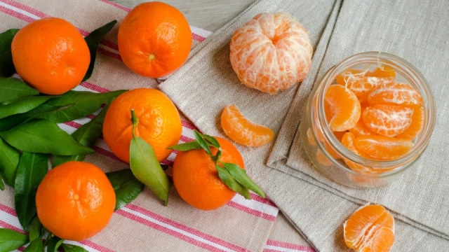 Have an orange. Great taste and makes your skin sing.