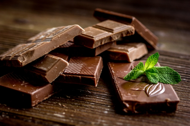Choosing dark chocolate over nutritionally hollow cookies or toffees for a snack will satiate you much more effectively.