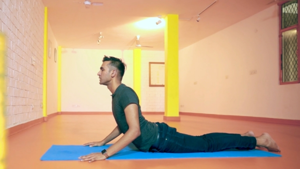 A stiff back can render you useless. Give these simple asanas a shot.