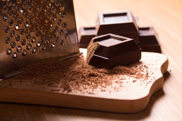 Grate chocolate in bulk - enough to sprinkle over the cupcakes for your dinner party.